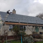 new roofing being installed on bungalow