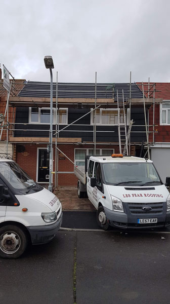 scaffolding on home with les fear van outside